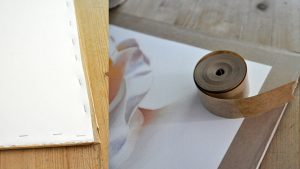 Stretch your watercolor paper and fix it on the board using some tape or staple it.